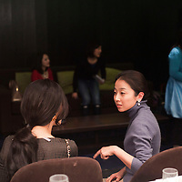BEIJING, DECEMBER-15 :   Miss X ( name ?)  (R), partner of  Sara Jane Ho 's etiquette company , speaks with an attendee of a dinner where Ho will teach European etiquette.  In 2013 the 27- year -old Harvard Business School graduate will start  Institute Sarita, a boutique finishing school offering courses in Mandarin for high prices . Ho plans  to teach affluent Chinese the ''importance of being finished'' . Ho learnt her skills at Institut Villa Pierrefeu, Switzerland's last traditional finishing school, where a six-week course covering skills including flower arranging, hostessing and table-setting costs around $20,000.
