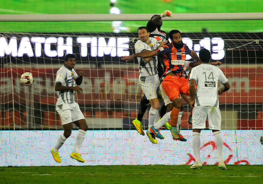 Edel Apoula Edima Bete of Atletico de Kolkata in action during match 44 of the Hero Indian Super League between FC Pune City and Atletico de Kolkata FC held at the Shree Shiv Chhatrapati Sports Complex Stadium, Pune, India on the 29th November 2014.<br /> <br /> Photo by:  Pal Pillai/ ISL/ SPORTZPICS