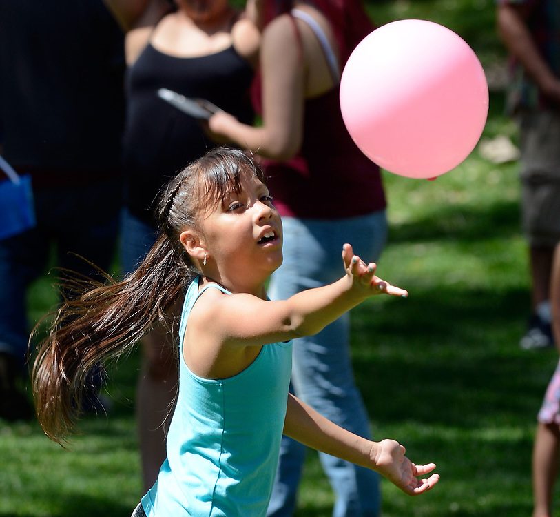 "jt041517b/a sec/jim thompson/ Poloma Sigala-8 plays with a balloon at the Victory Outreach Albuquerque Church's HOPE Easter Egg Hunt and care Basket Giveaway at Roosevelt Park. Which is part of the ""Operation Hope/I (heart) ABQ "" campaign.   Saturday April 15, 2017. (Jim Thompson/Albuquerque Journal)"