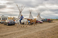 John Real Bird, Real Bird camp, Crow Fair on Crow Reservation, returns from watering horses