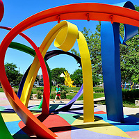 Little Girl Walking in Park Beside Colorful Abstract Art in Omaha, Nebraska<br />