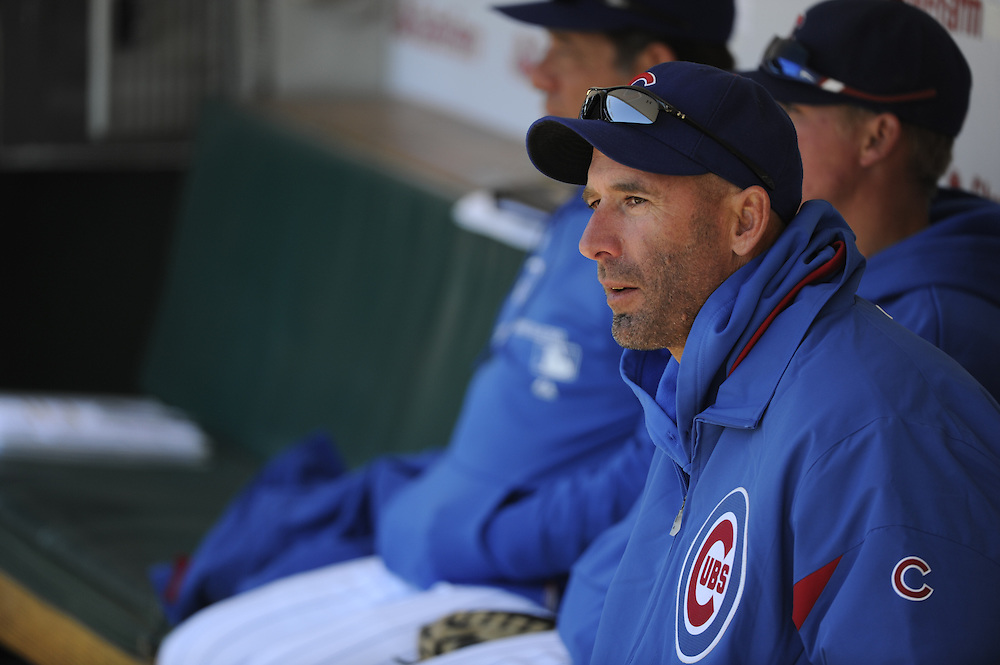 CHICAGO - APRIL  11:  Manager Dale Sveum #33 of the Chicago Cubs looks on during the game against the Milwaukee Brewers on April 11, 2012 at Wrigley Field in Chicago, Illinois.  The Brewers defeated the Cubs 2-1.  (Photo by Ron Vesely)   Subject:  Dale Sveum