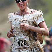 SHOT 6/4/11 2:50:36 PM - A competitor in a wedding dress competes in the Mud Run at the 10th Annual Teva Mountain Games in Vail, Co. Professional and amateur outdoor adventure athletes from the Vail Valley and around the world will converge upon the mountains and rivers of Vail to compete in eight sports and 23 disciplines including: x-country, freeride, slopestyle and road cycling, freestyle, 8-Ball, sprint and extreme kayaking, raft cross, World Cup Bouldering, stand up paddle sprint and surf cross, as well as trail, mud and road running, dog comps and the GNC Ultimate Mountain Challenge.. (Photo by Marc Piscotty / © 2010)