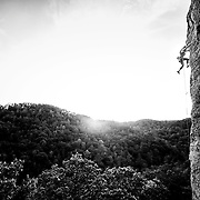 "Christine Shiba climbing ""No Place Like Home,"" 5.11c, at the Red River Gorge in Kentucky. Photography by Kris Ugarriza"