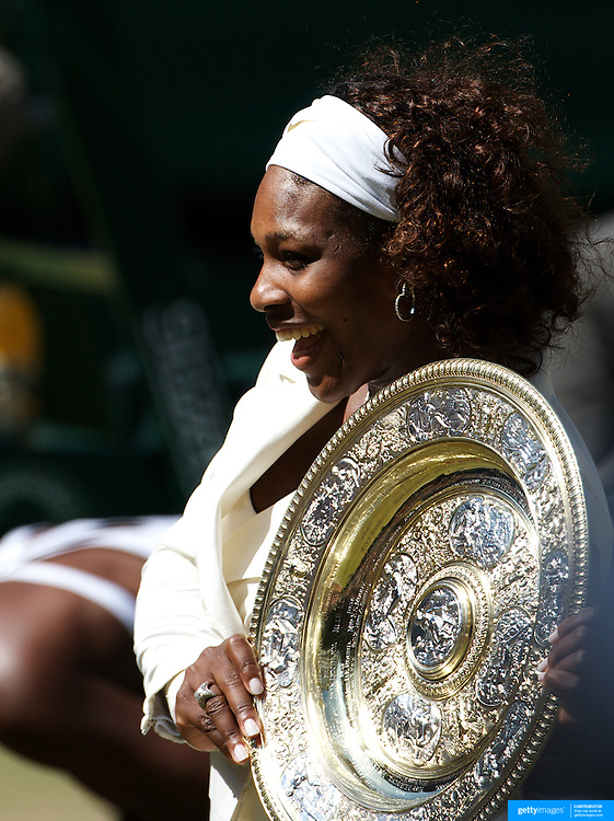Serena Williams, USA, with the trophy after her victory over sister Venus Williams, USA, in the Ladies Singles Final at the All England Lawn Tennis Championships at Wimbledon, London, England on Saturday, July 04, 2009. Photo Tim Clayton