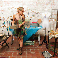 Suzi Drake looks over her booth during Fashion On Front Thursday August 21, 2014 at Bakery 105 in Wilmington, N.C.(Jason A. Frizzelle)