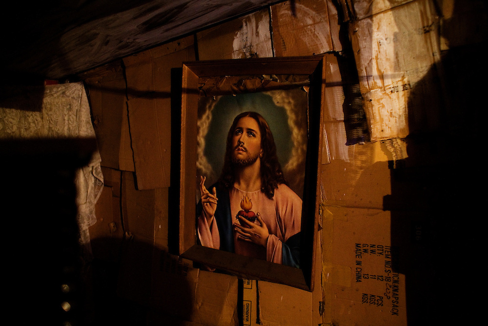 A portrait of Jesus hangs in a home in the Stara Gazela settlement of Belgrade. August 2009.