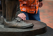 Hoping for a bit of good fortune, a fan touches the foot of an Earl Weaver statue during opening day at Oriole Park at Camden Yards in Baltimore, Monday, April 4, 2016.  The Baltimore Orioles defeated the Minnesota Twins 3-2.