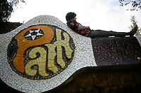 20110903 - Barcelona, Spain - A visitor rests on the wall of  Park Guell in Barcelona, Spain.  Photo by Matthew Healey