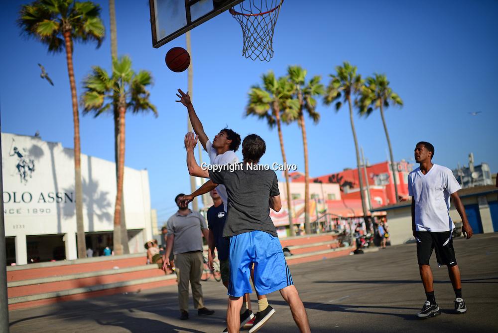 Street basketball game in Venice Beach, Los Angeles, California.