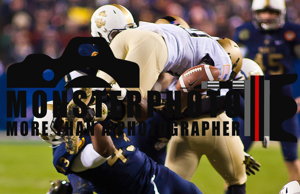 Navy freshman fullback Noah Copeland #43 upends Army punt returner Scott Williams #10 causing Williams to fumble the ball at the ARMY 27 early in the 4th quarter of the 112th version of this storied rivalry game between Army and Navy Saturday, Dec. 10, 2011 at Fed EX field in Landover Md.<br /> <br /> Navy set the tone in the fourth quarter while Army mistake cost them the game, Navy defeats Army 27-21 in front of 82,000 at Fed EX Field in Landover Md.
