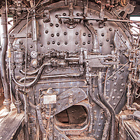 An old steam locomotive boiler