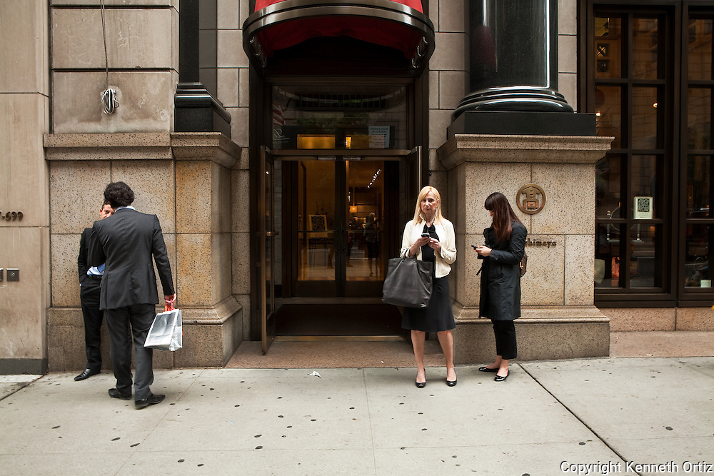 Walking down 5th Avenue in New York City is a great place to people watch.  These are a few examples.