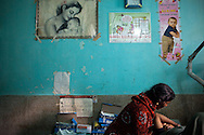 Mena Devi, left, comforts her daughter Arti Devi after a difficult first birth at the Anugrah Narayan Magadh Medical College Hospital in the town of Gaya in the state of Bihar, India, December 7, 2011.  Arti came to the hospital five days before suffering from eclampsia, edema, and severe anemia. At birth, her baby did not breath initially and a nurse administered oxygen, and performed mouth-to-mouth resuscitation and lung stimulation for almost ten minutes before he could breath on his own.