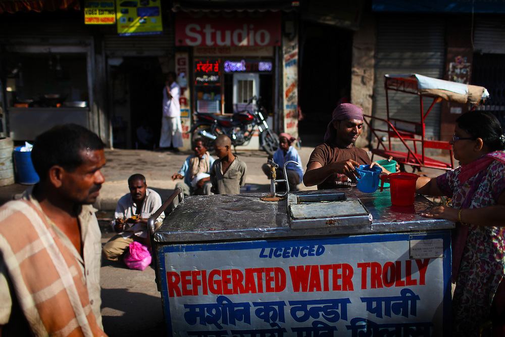 A refigerated water trolly provides water to the Bhai Daya Singh Charitable Trust during a early morning feeding in Delhi.