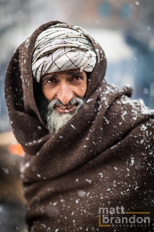 A classic Gujjar face framed by his distinct turban and woolen shawl. Pahalgam, Kashmir, India