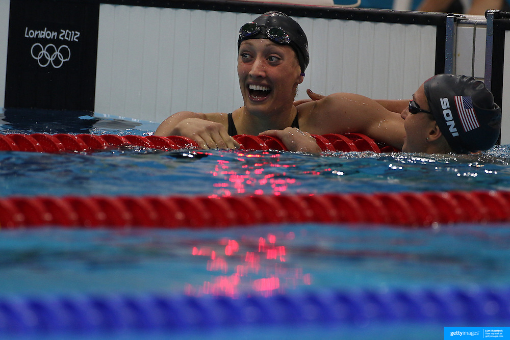 Rebecca Soni, USA (right), and team mate Breeja Larson after the Women's 100m Breaststroke Semi finals at the Aquatic Centre at Olympic Park, Stratford during the London 2012 Olympic games. London, UK. 29th July 2012. Photo Tim Clayton