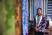 A Karen girl with hand made cloth cotton in a village in northern Thailand.