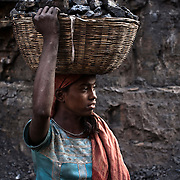 13 year old Shanti Sahuji is seen carrying raw coal from the open cast mines in Borapahari in Jharia, Jharkhand, India.  Photo: Sanjit Das