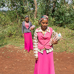 Kamila Khader and Shimla Mangastu walk to school next to the coffee plantation Welinsu in Limu, Ethiopia.