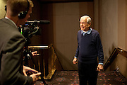 GOP presidential candidate Rep. Ron Paul speaks to reporters backstage at a campaign rally in the Grand Sierra Resort in Reno, Nev., February 2, 2012.