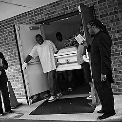 Pall bearers carry out the casket of Shanika Lee, 24 of D.C. who was shot and killed on the 3200 block of E street S.E. Washington D.C.