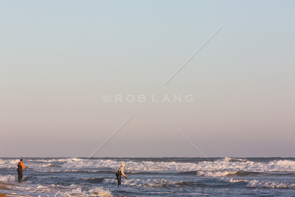 Two fishermen surf fishing in the ocean rob lang images for Montauk ny fishing