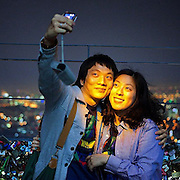"Young couple photographing each other during an evening mood at the lowest observation deck of N Seoul Tower in the South Korean metropolis. From my book project ""A Beautiful Strange Dream"". #Seoul #soul #southkorea #korea #couple #selfportrait #selfie #camera #metropolis #latergram #abeautifulstrangedream #südkorea #Asia #dailylife"