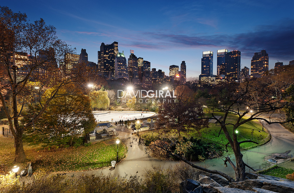 Landscape and cityscape of the New-York City Skyline and the ice rink in Central Park at the end of the fall season, USA<br /> <br /> manually blended from 5 exposures