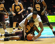 "Central Michigan's Crystal Bradford (23) and Ole Miss' Nikki Byrd (22) go for a loose ball at C.M. ""Tad"" Smith Coliseum in Oxford, Miss. on Wednesday, December 14, 2011. (AP Photo/Oxford Eagle, Bruce Newman)"