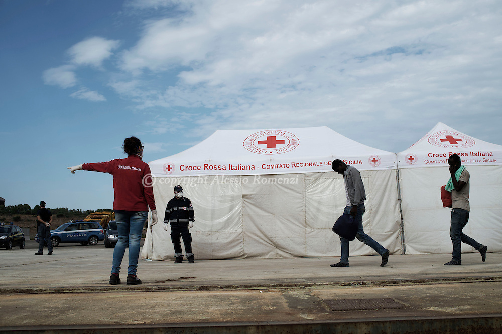 Italy: MSF Dignity1: Italian Red Cross members receive migrants rescued at sea on the deck of the Augusta port on August 25, 2015. Alessio Romenzi