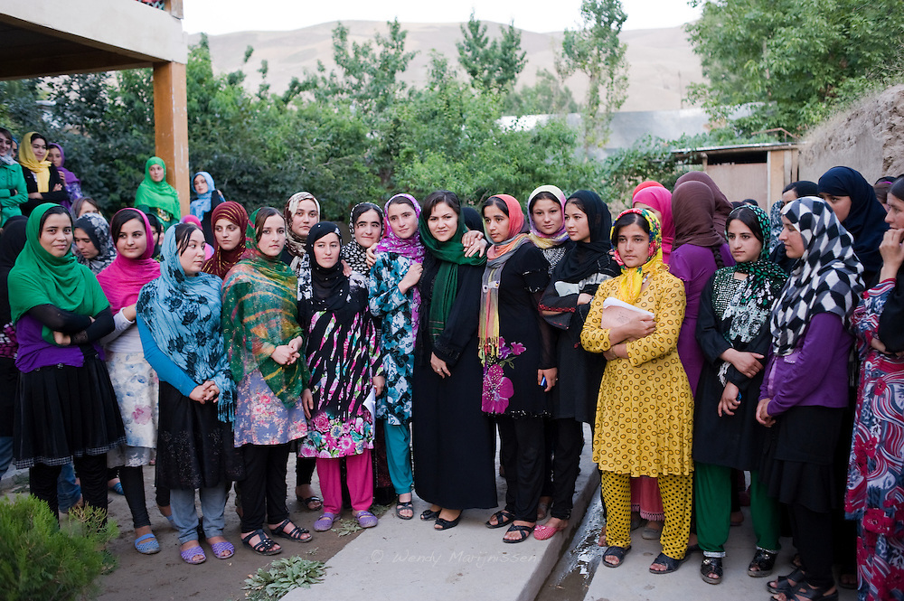 MP Ms. Fawzia Koofi surrounded by dozens of female University Students outside their hostel. Afghanistan has long had one of the poorest education records in the world, and up until 2001 under Taliban rule girls in Afghanistan were denied the right to go to school. Faizabad, Afghanistan, 2012