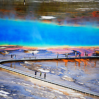 Visitors tour Yellowstone National Park's Grand Prismatic Springs Sept. 24, 2011.