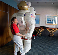 A NASA worker inflates a spacesuit at The Intrepid