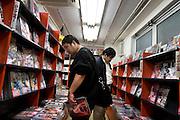 "Men buying ""dojin"" (fans' manga) in Toranoana manga store, in Akihabara district of Tokyo on Thursday 12th of October 2006."