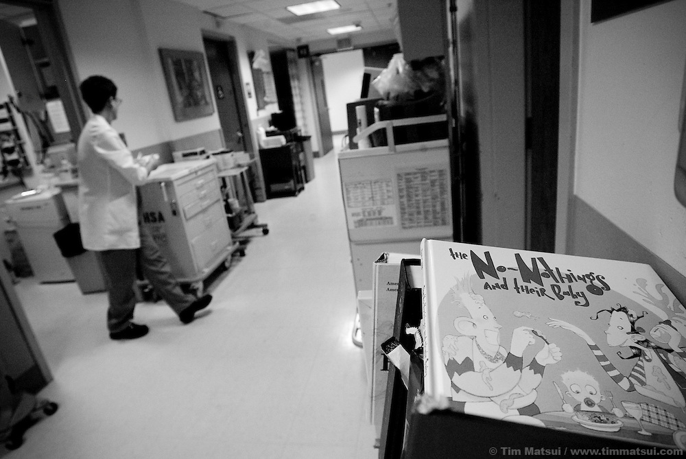 A children's book lies on a cart in the Harborview Emergency Room in Seattle as Sexual Assault Nurse Examiner Alison Cathro packages evidence from the forensic exam of a 13 year-old she treated in the wee hours of a Monday morning.