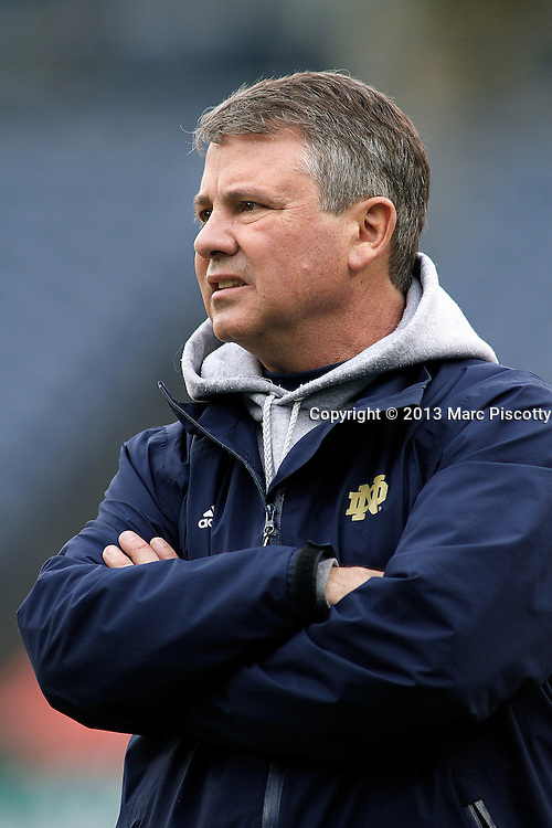 SHOT 3/16/13 5:01:06 PM - Notre Dame head lacrosse coach Kevin Corrigan coaches against Denver during their college lacrosse game at the Whitman's Sampler Mile High Classic at Sports Authority Field at Mile High in Denver, Co. on Saturday March 16, 2013. Notre Dame won the game 13-12 in overtime. (Photo by Marc Piscotty / © 2013)