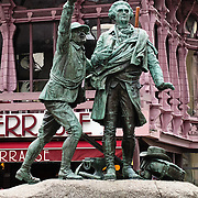 Statues of H.B. De Saussure and Jacques Balmat look up at Mont Blanc in downtown Chamonix, France, Europe. Horace-Bénédict de Saussure (1740-1799) was a Genevan aristocrat, physicist and Alpine traveller, often considered the founder of alpinism and the first person to build a successful solar oven. A chamois hunter and collector of crystals, Balmat completed the first ascent of Mont Blanc with physician Michel-Gabriel Paccard on August 8, 1786.