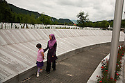 Selja Mustafic, right, guides her sister Lehana Mustafic past a monument with the names of Srebrenica victims in the Potocari Memorial Center...Matt Lutton for The International Herald Tribune..Capture of Ratko Mladic. Srebrenica, Bosnia and Herzegovina. May 29, 2011.