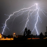 Lightning bolts fill the sky as a thunder storm passes over Bend late Monday night.