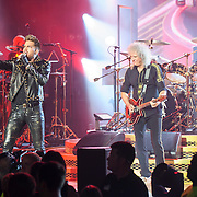 COLUMBIA, MD - July 20th, 2014 - Adam Lambert performs with Brian May and Roger Taylor of Queen at Merriweather Post Pavilion in Columbia, MD. Lambert is handling the majority of vocal duties for the group on their current US tour, but both May and Taylor sang lead vocals on songs from the group's vast back catalogue. (Photo by Kyle Gustafson / For The Washington Post)