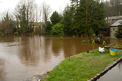 © Licensed to London News Pictures. 22/12/2012. Helston, UK. A flooded garden next to the River Cober which burst its banks over night after heavy rain across the South West. The Environment Agency issued a Severe flood warning for the River Cober. Photo credit : Ashley Hugo/LNP