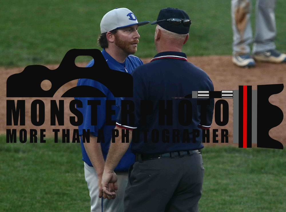Dover Senators Manager Dave Gordon argues with the umpire during a DIAA baseball semifinal game between the St. Marks Spartans and Dover Senators at Frawley Stadium Saturday. May 28, 2016 in Wilmington.