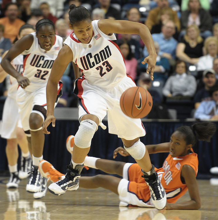 Connecticut's Maya Moore (23) steals the ball from Clemson's Kirstyn Wright, right, in the first half of an NCAA college basketball game in Storrs, Conn., Sunday, Nov. 29, 2009. Connecticut's Kalana Greene is at left. (AP Photo/Jessica Hill)