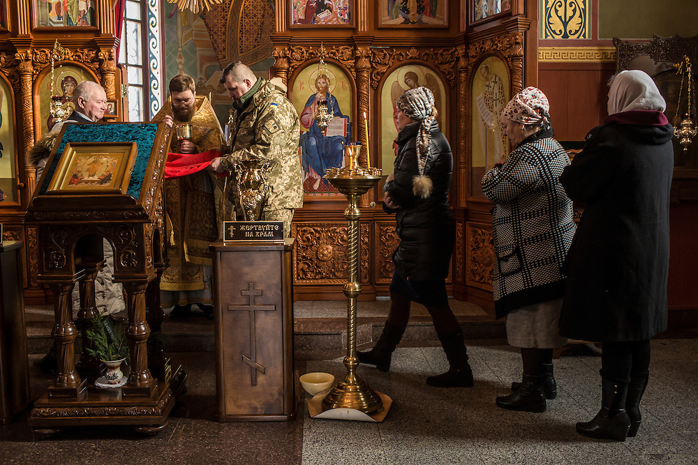 Priest Rostislav Morozov leads parishoners at the Holy Church of the Epiphany during a service on Sunday, February 14, 2016 in Karlivka, Ukraine.