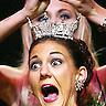 DAVENPORT, IOWA - JUNE 14, 2003: Miss Iowa 2002, Stephanie Moore, crowns Nicole White as Miss Iowa 2003 at the Adler Theatre.