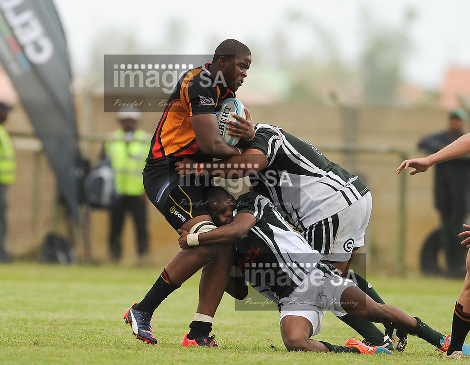 GEORGE, SOUTH AFRICA - Saturday 7 March 2015, Nqubeko Zulu of Vaseline Wanderers is tackled by 2 players of Pacaltsdorp Evergreens during the third round match of the Cell C Community Cup between Pacaltsdorp Evergreens and Vaseline Wanderers at Pacaltsdorp Sports Grounds, George<br /> Photo by Roger Sedres/ImageSA/ SARU
