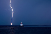 WI00183-00...WISCONSIN - Lightning storm during sunrise at Wisconsin Point Lighthouse on Lake Superior near the town of Superior.