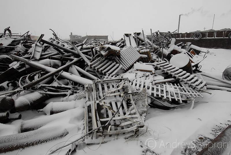 Metal scrap on the coast of the Chukchi peninsula. Russia