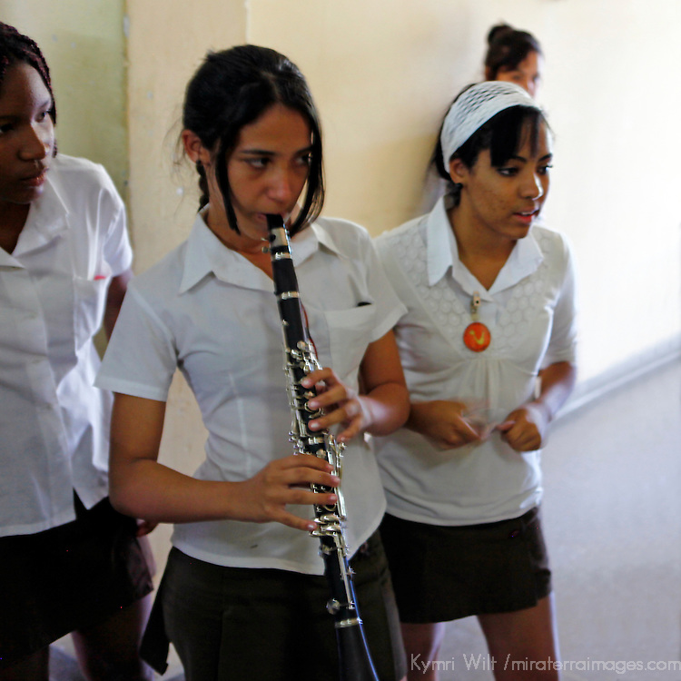 Central America, Cuba, Santa Clara. Girl playing clarinet at the Santa Clara Musical School of Art.